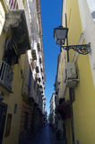 Lantern and blue sky in narrow street in Sorrento,Italy Stock Photos