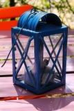 Lantern. Blue lantern on violet table Royalty Free Stock Photo