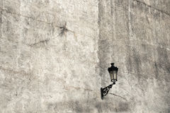 The lantern. At the bottom of the pictures, stone grey wall background stone, ancient times Stock Photo