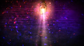 Lantern on the building, night, neon, spotlight, smoke. Background of an empty old brick wall. royalty free stock photography