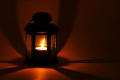 Lantern with burning candle. In the dark Stock Photos