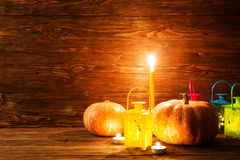 Lantern with burning candles and pumpkins Stock Photo
