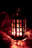 Lantern burning in the dark Stock Photos