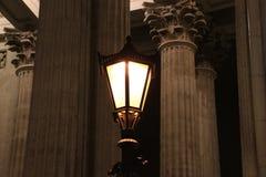 Lantern burning in the dark. A lantern burning in the dark against the background of columns Stock Photos