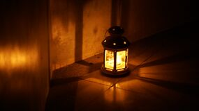 Lantern burning at night Stock Photo