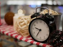 Lantern candle and alarm clock with red and white fabric artific Royalty Free Stock Images