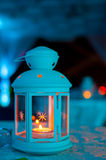 Lantern with candle. Blue light, elegant candle holder, wedding candle holder, candle holder with white candles, candle holder, candle holder with ambient light royalty free stock photography
