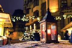 Lantern with a candle on a Christmas fair Royalty Free Stock Images