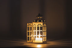 Lantern with a candle in a dark background Stock Images