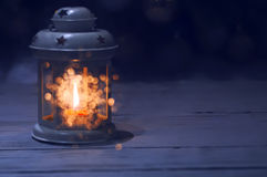 Lantern with a candle inside in the dark Royalty Free Stock Images