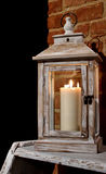 Lantern,candle,light,relax. Lantern with a lit candle on the table Royalty Free Stock Photography
