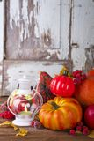 Lantern with candle, pumpkins and autumn decorations Stock Image