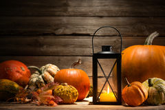 Lantern with candle and  pumpkins Royalty Free Stock Image