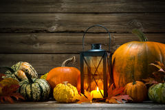Lantern with candle and  pumpkins Stock Image