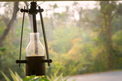Lantern  Candle. Vintage candle lantern with blurred nature view background Stock Image