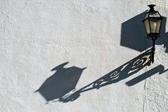 Lantern casting shadow on wall Stock Photos