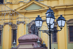 Lantern and the Cathedral of St. George. The old wrought-iron lanterns in front of the Cathedral of Saint George in the square in Timisoara, Romania Royalty Free Stock Photo