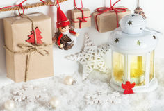 Lantern and Christmas gifts. White lantern and Christmas gifts Royalty Free Stock Image