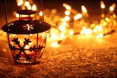 Lantern. And Christmas lights burning in dark royalty free stock images
