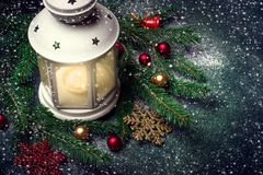 Lantern and Christmas tree branches on a dark background Stock Image