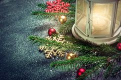 Lantern and Christmas tree branches on a dark blue green backgro Stock Photography