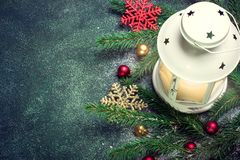 Lantern and Christmas tree branches on a dark blue green backgro Royalty Free Stock Photo