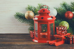Lantern and Christmas tree over snow on wooden background Stock Images