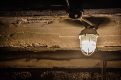 Lantern on a concrete ceiling in the basement royalty free stock photography