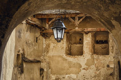 Lantern. In The Courtyard Of The Medieval Town Of Sighisoara, Romania Royalty Free Stock Image