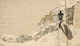 Lantern on cracked wall. Lantern on cracked and faded old wall. Grunged and cracked background Royalty Free Stock Photos