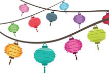 Lantern decorations. String of bright hanging lantern decorations on white Stock Image