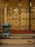 Lantern door. Metal bronze lantern in front of a golden door to a Japanese Buddhist temple Stock Images