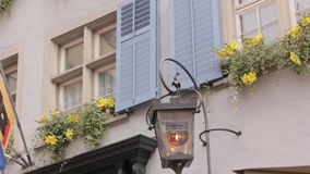 Lantern Emblem Zurich Canton. Zurich, Switzerland - 10 02 2018: The emblem on lantern Zurich Canton and flowers stock video footage