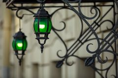 Lantern at the entrance to the house. vintage green street lamp. stock photography