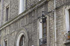Lantern on a facade. Detail of an object lighting Royalty Free Stock Images