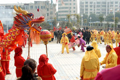 Lantern festival. Chinese   celebrate the   lantern festival in a traditional way,the play the dragon boat and play dragon dance in a square. ,February 17,2011 Stock Photo