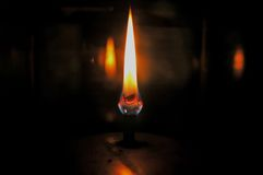 Lantern Flames. Candles burning in a lantern royalty free stock image