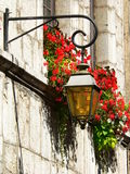 Lantern and flowers. Old street lantern in Annecy, France Royalty Free Stock Image