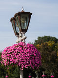 Lantern with flowers in park Royalty Free Stock Photo