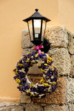 Lantern with flowers. Lantern on the wall with beautiful flowers stock photos