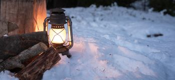 Lantern in the forest lighting up to chop firewood royalty free stock photos