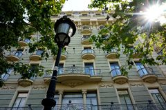 Lantern in front of the facade of one of the beautiful houses in Barcelona. stock photography