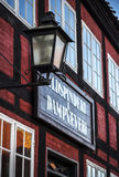Lantern in front of a store in the old city in Aarhus Royalty Free Stock Image