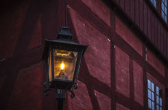 Lantern in front of a store in the old city in Aarhus Royalty Free Stock Photo