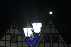 lantern in front of two old houses, at night Royalty Free Stock Photography