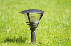 Lantern on the  grass Stock Photos