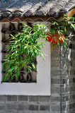 Lantern and green bamboo on Chinese house. Red lantern and green bamboo on Chinese traditional house, shown as traditional architecture style, residence feature Stock Photo