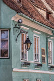 Lantern on a green house in Sighisoara Royalty Free Stock Photo