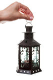Lantern in a hand Stock Photography