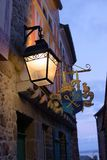 Lantern hanging in beautiful alley soft glow france mont saint michel royalty free stock images